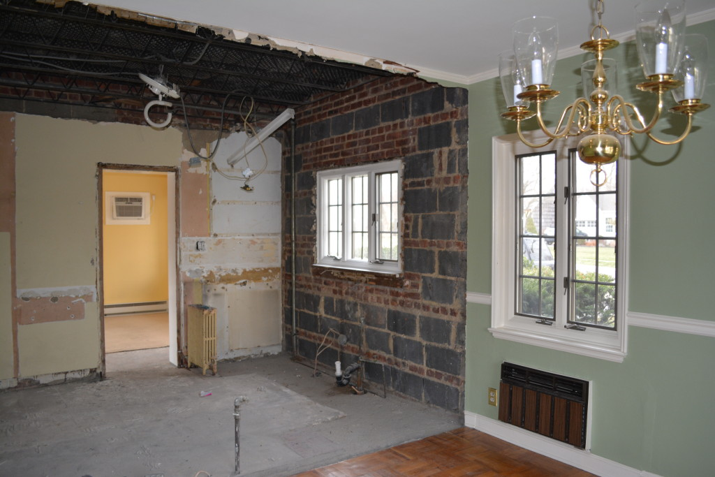 Here's the view from dining room into kitchen. Please enjoy the extremely sturdy walls, cement floor and hapless radiator.