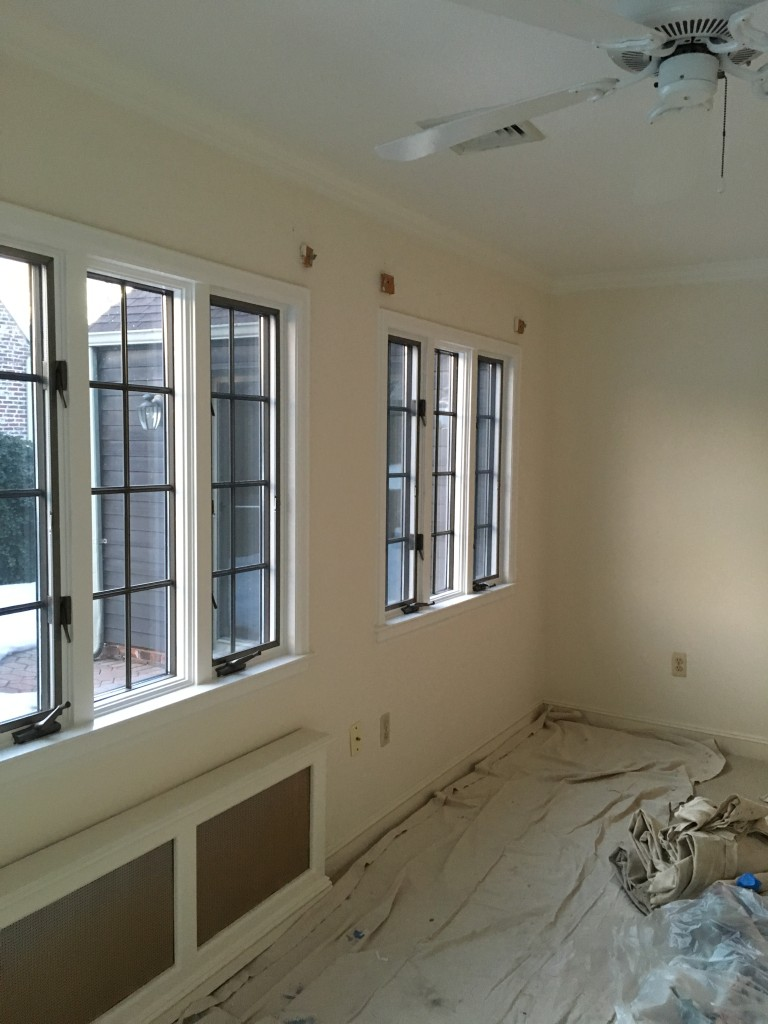 Window treatments down and ready for painting.