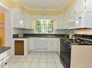 I would have loved this kitchen back when I first married with its painted white cabinets and Hunter green counters.